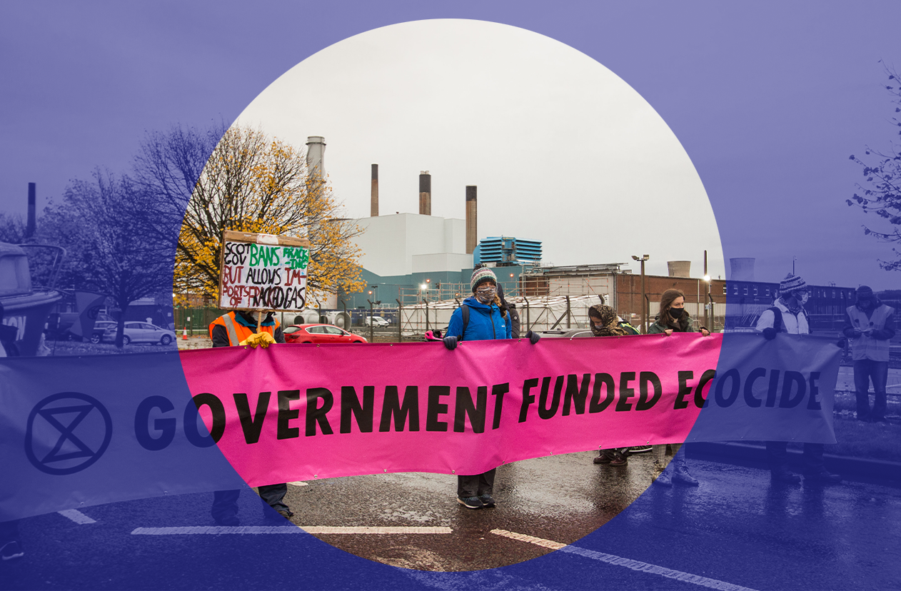 Extinction Rebellion sign 'Government Funded Ecocide'